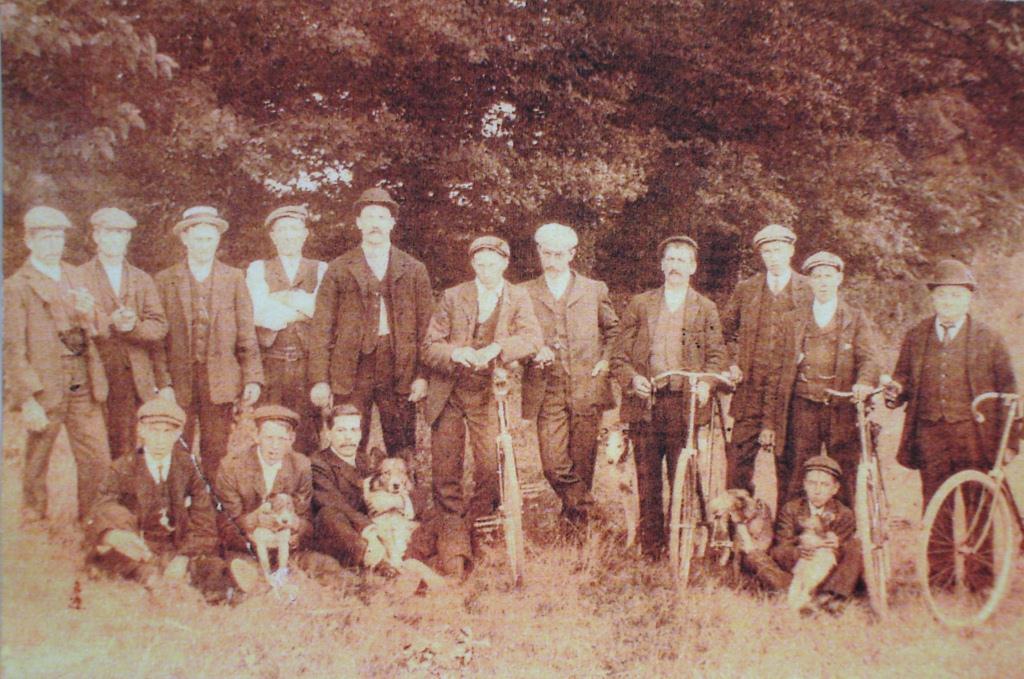 Rat catchers by Hanley Swan pond, c. 1910