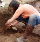 Janey Green reassembles three sections of pot recovered from Trench 6