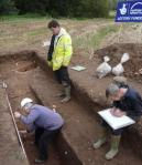 Paul Denning and Jane Hennessy record progress in Trench 6